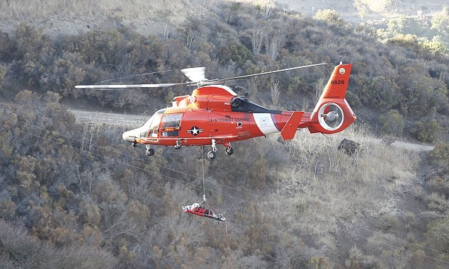 1413316370074_wps_23_A_Coast_Guard_helicopter_