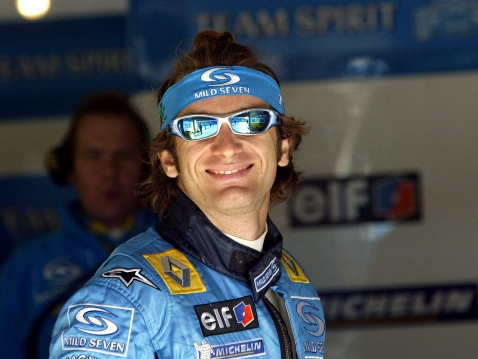 Italian Jarno Trulli of Renault smiles at the team pits during training session of the European Grand Prix