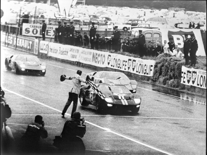Trio of Ford GT40 Mk IIs cross finish line at Le Mans 1966